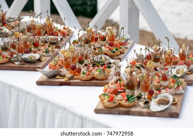 Snacks, fish and meat specialities on the buffet. Desserts. A gala reception. Served tables. Catering