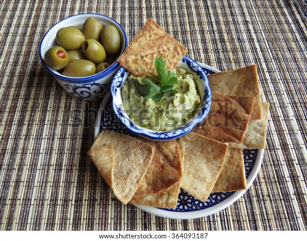 Snacks include green stuffed olives, kale hummus and pita chips