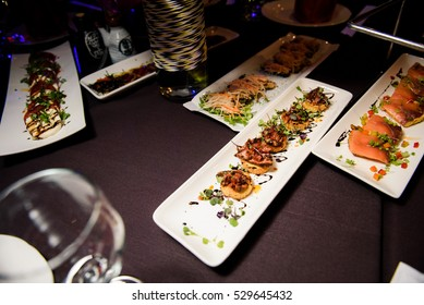 Snacks made of salted fish served on long square plates