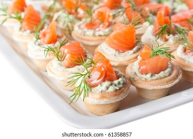 Snacks with salmon, cheese and grapes (close-up)