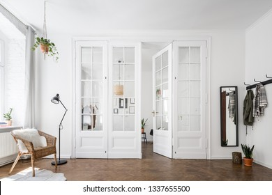 Snadinavian living room with beautiful, white, old door in a renovated townhouse