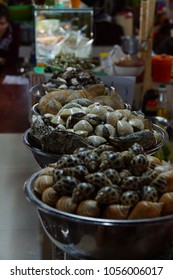 Snails, clams and other seafood for sale  at the market, Saigon (Ho Chi Minh City),  Vietnam