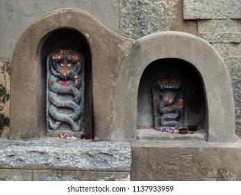 Snake deities - Lakshmi Narasimha Temple, Nuggehalli, Hassan District of Karnataka state, India. The temple was built in 1246 CE rule of Hoysala Empire.