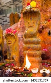 Snake Goddess Idol - Naga Devata. Nagula Chavithi, a festival to worship Nag Devatas. Pamula Putta. Snake Hole. Snake House red colored mud or soil. Snake worship - Image