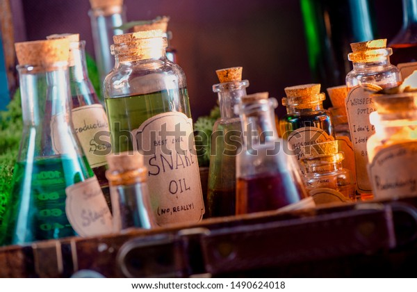 Snake Oil handwritten potion label. Fake remedy, homeopathy, and unscientific medicine concept.