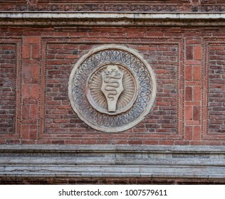 the snake, symbol of the ancient Lords of Milan,italy, on the red brick wall of an ancient building