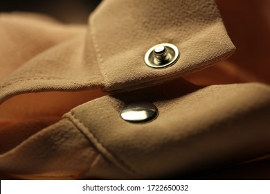 snap button on shirt sleeve