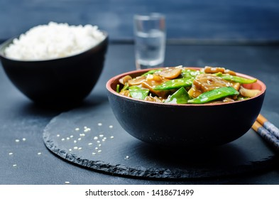 Snap peas Mushrooms Stir Fry with rice. toning. selective focus