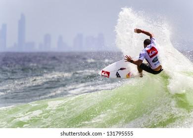 SNAPPER ROCKS, GOLD COAST, AUSTRALIA - 9 MARCH: Unidentified Surfer races the Quiksilver & Roxy Pro World Title Event. 9 March 2013, Snapper Rocks, Gold Coast, Australia