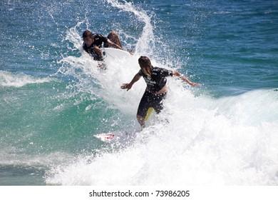 SNAPPER ROCKS, GOLD COAST, AUSTRALIA - 25 FEB: Unidentified Surfer races the Quiksilver & Roxy Pro World Title Event. 25 February 2011, Snapper Rocks, Gold Coast, Australia