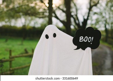 Snapshot of a ghost with a sheet and a speech bubble saying boo.
