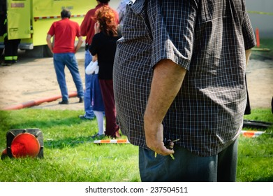 snapshot of an overweight man on street of  rural country, Quebec, Canada