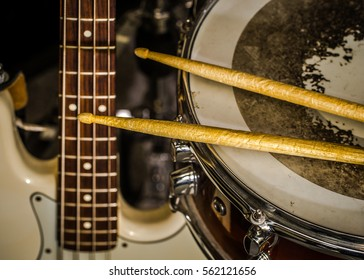 snare drum with drumsticks and bass guitar, closeup, concept musical composition and creativity