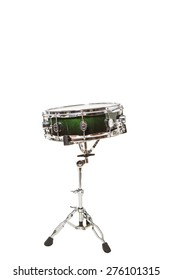 Snare drum at the front on a white background with drumsticks on it