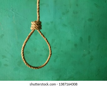 The snare, the rope loops hanging against the background of the slum green walls