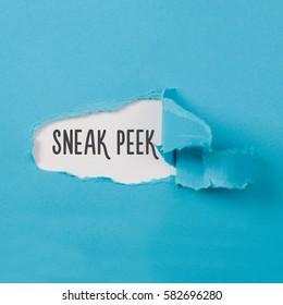 Sneak Peek message on torn blue paper revealing secret behind ripped opening.