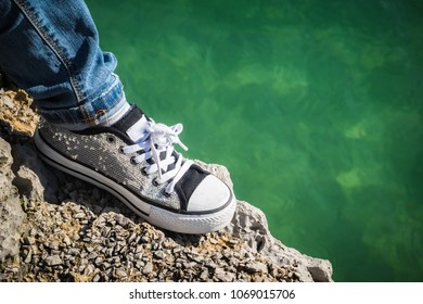 Sneaker closeup next to the sea