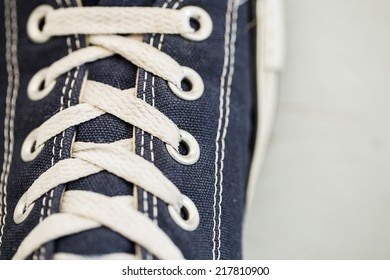 Sneaker with white shoelace