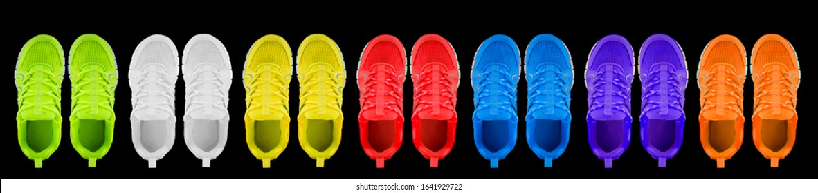 Sneakers in different colors on a black background. Seamless texture of multi-colored shoes.