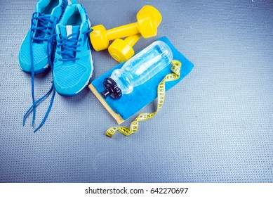 Sneakers and dumbbells fitness