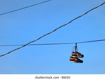 Sneakers hanging from utility wires