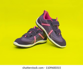 Sneakers isolated on the yellow background