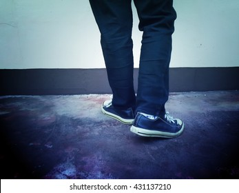 sneakers leg shoes wall  grunge background