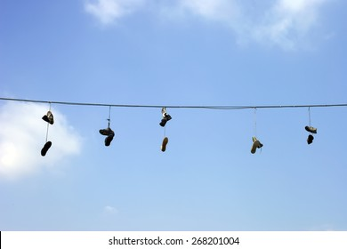 Sneakers on a electric wire