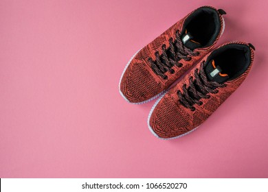 Sneakers on a pink background top view.