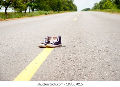 sneakers on the road.