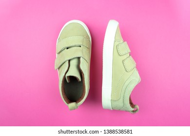 Sneakers  on a trendy pink color background, top view, summer shoes. Flat lay.