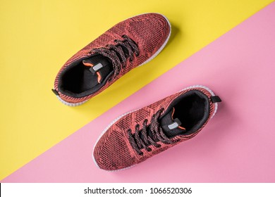 Sneakers on a yellow and pink background top view.