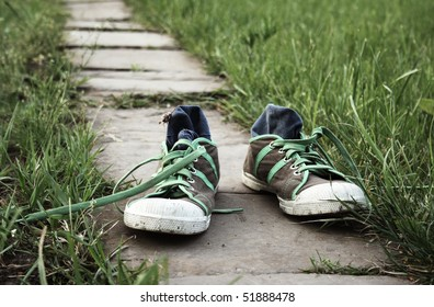 sneakers outdoor on a green grass
