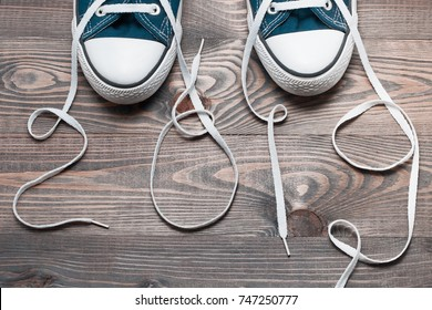 Sneakers similar to keds on a New Year rustic wooden background, Christmas gift to an athlete, white laces written 2019
