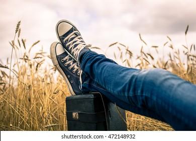 Sneakers in a wheat field.