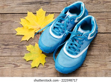 sneakers and yellow leaves