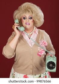 Sneering retro style drag queen on telephone