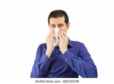 sneezing businessman sick blowing nose with white background