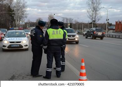 SNEGIRI, RUSSIA - MARCH 14, 2014:Employees dorozhno-patrol service controlled movement.