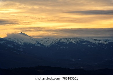 Snezka peak, most prominent point of Silesian Ridge in Krkonose as seen from Lion mountain in Rudawy. Natural mountain border between Poland and Czech Republic. Beautiful golden hour view while hiking