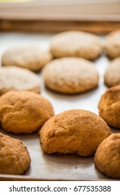 Snickerdoodle cookies on a sheet pan, freshly baked