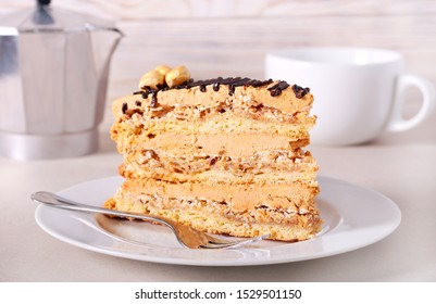 Snickers cake  with caramel, nuts and buttercream on plate