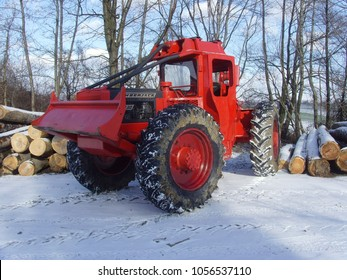 Snina, Slovakia - 12 February 2011: Red Timberjack 230 Cable Skidder in Forrest Working with Logs During Winter