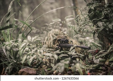 Sniper with ghillie suit, and M24 Sniper riffle