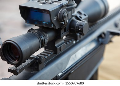Sniper gun, optics scopes close up. Elements of the sniper rifle with tactical body . Selective focus