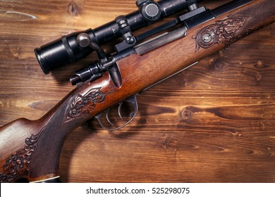 Sniper on wooden background