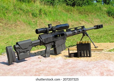 Sniper rifle .50 BMG caliber with riflescope for long range.
