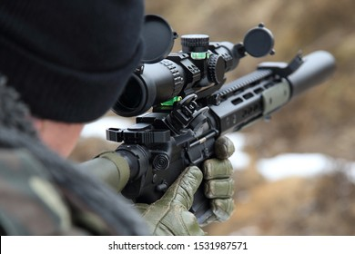 sniper rifle in the hands of a sniper