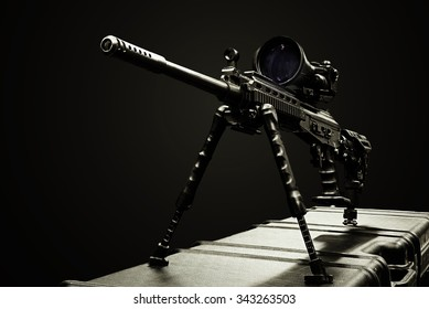 sniper rifle on the case on the dark background