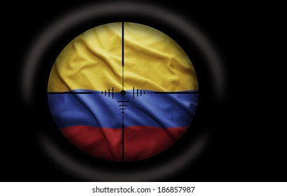 Sniper scope aimed at the Colombian flag